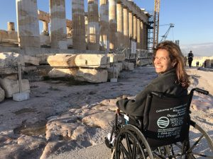 Woman in Wheelchair in front of Ruins During Land Tour