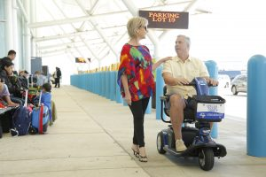 Couple with Husband using Scooter at Cruise Port Terminal